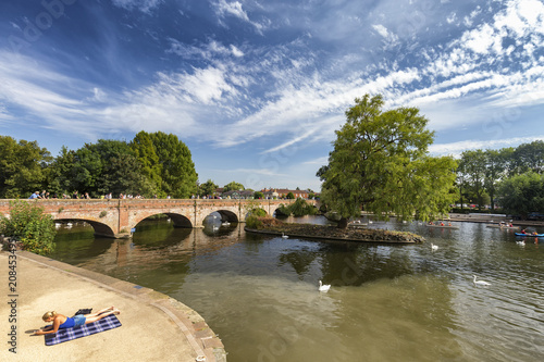 STRATFORD-UPON-AVON, UNITED KINGDOM - AUGUST 24: An unidentified woman relaxes at the River Avon in Straford-upon-Avon, United Kingdom on August 24, 2016 Canvas Print