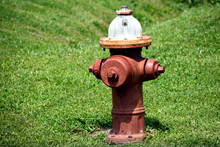 Red Fire Hydrant With White Ca...