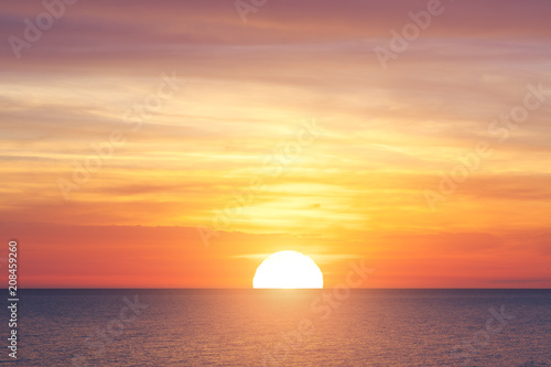 Photo Stands Sea sunset Big sun and sea sunset