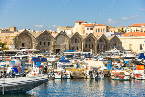 Foto op Aluminium Stad aan het water View of the Venetian port of Chania with the ancient venetian shipyards and the pleasure boats