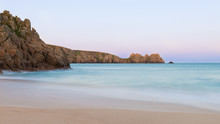 Stunning Sunset Landscape Image Of Porthcurno Beach On South Cornwall Coast In England