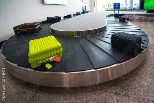 Fotografie, Obraz  Suitcase or luggage is conveyed through the conveyor belt