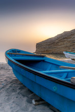 A Fisherman Boat At Sunrise On...