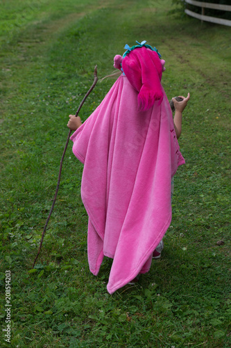 Girl playing wizard with walking stick and pink robe Canvas Print