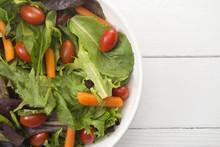 Bowl Of Healthy Salad With Carrots And Tomatoes