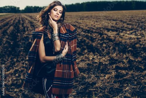 Poster Gypsy female posing in field