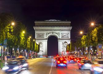 FototapetaTriumphal arch (Arc de Triomphe) at night, Paris, France