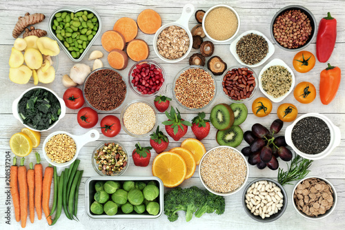 Assortiment Fresh super food concept with fruit, vegetables, grains, cereals, pulses, seeds, herbs and spice. Foods high in fibre, anthocyanins, antioxidants, smart carbohydrates, minerals and vitamins.