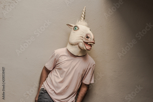 Photo  Unicorn funny plastic mask photograph