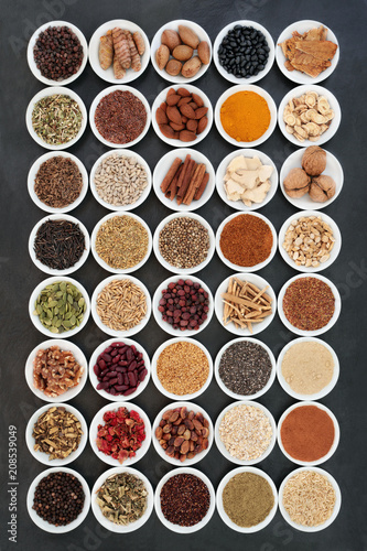 In de dag Assortiment Healthy heart food ingredients with herbs and spices used in herbal medicine on slate background. Large collection high in vitamins, minerals, antioxidants, fibre and omega 3 fatty acids.