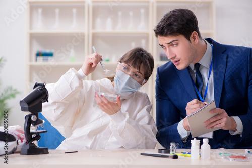 Fototapeta Expert criminologist working in the lab for evidence obraz na płótnie