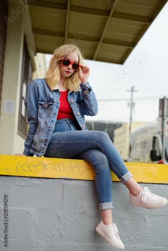 Beautiful Blonde Teen with Red Sunglasses in Urban Setting Wallpaper Mural