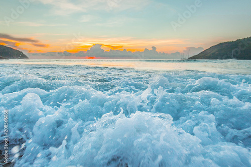 Raging waves at sunset Wallpaper Mural