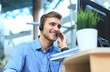 canvas print picture - Smiling friendly handsome young male call centre operator.