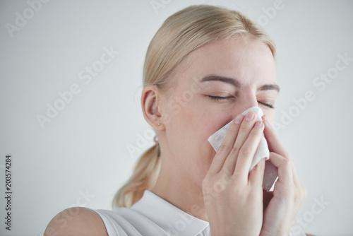 Fotografie, Obraz  Rhinitis. Girl with napkin on white background