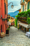 Fototapeta Uliczki - Stunning scenic street with colorful houses and flowers in Bellagio