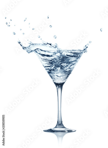 Foto op Plexiglas Alcohol single glass of water with splash isolated on white background