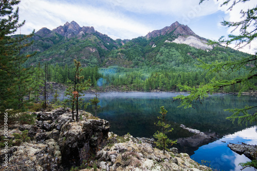 Deurstickers Bomen Beautiful view to fir trees and lake in mountains, natural landscape. Russia, Siberia
