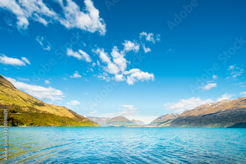 Tuinposter Blauwe jeans Beautiful landscape of Alps mountain and lake on a sunny day with blue sky.