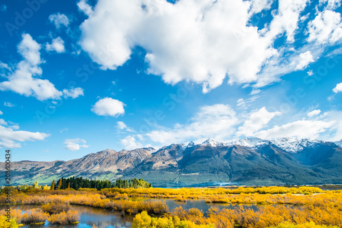 Spoed Foto op Canvas Pool Beautiful landscape of Alps mountain and lake on a sunny day with blue sky.