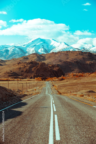 Keuken foto achterwand Turkoois Landscape with beautiful empty mountain road. Travel background. Highway at mountains.