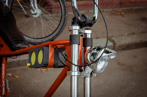 Deurstickers Fiets headlight and music concept with small loudspeaker on on the frame of the bike.