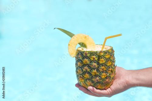 Fotobehang Cocktail Exotic pineapple cocktail near pool. Pina colada