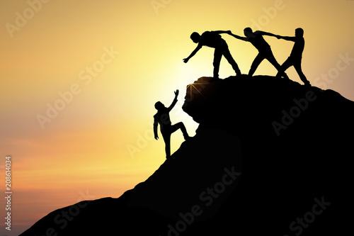 Fotografia  Assistance, teamwork and achievement concept