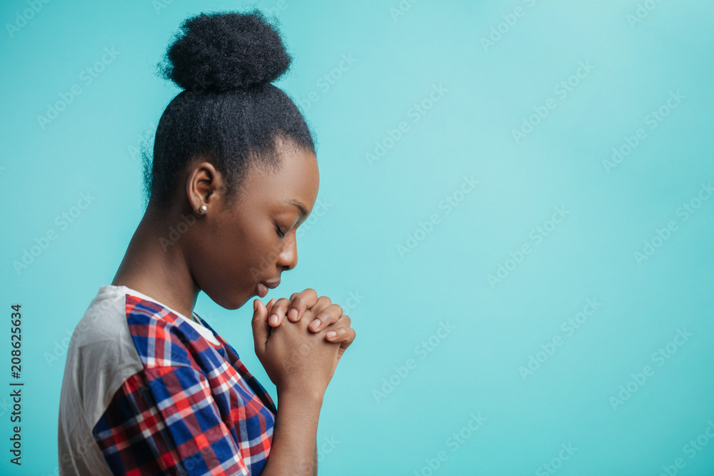 Fototapety, obrazy: close up side view portrait of black girl with lively faith. expiatoryfaith. mixed race girl is asking forgiveness because she has done a lot of mistakes and sins. copyspace. profile