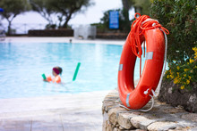 Lifebuoy By The Pool At Summer...