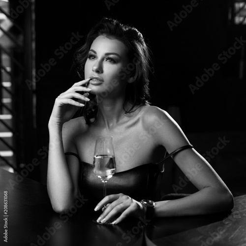 Elegant Young Woman Sitting In Bar And Having Good Time Alone
