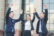 businessman and businesswoman teamwork arms up with smile and happy together for winning and success at outdoor front of office building. business success team concept.