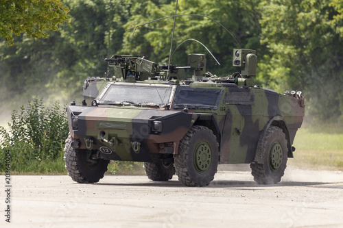 Leinwand Poster German light armoured  reconnaissance vehicle drives on a road