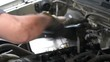 4k movie of mechanic repairing an old car. Under the hood of the car checks the work of carb and engine