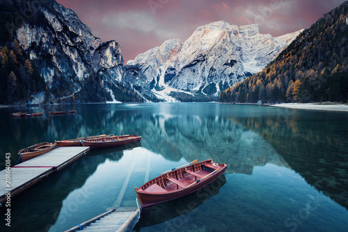 Foto op Canvas Blauwe jeans Wooden boat at the alpine mountain lake