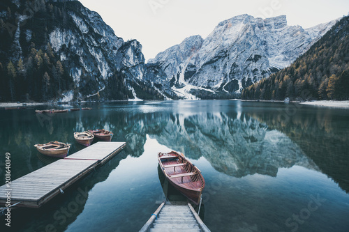 Photo Stands Lake Wooden boat at the alpine mountain lake