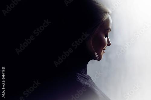 Fotografie, Obraz  Portrait of a young calm woman in profile