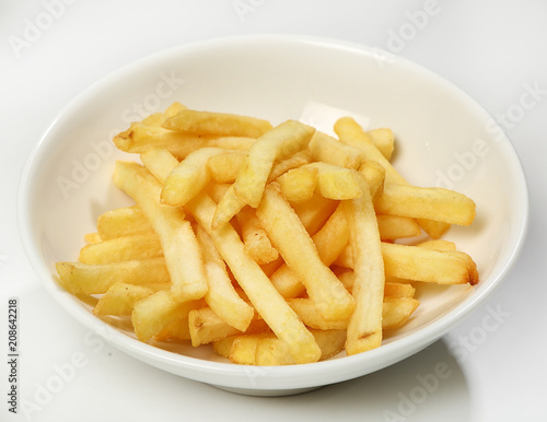Láminas  Garnish of french fries in a white plate on a white background