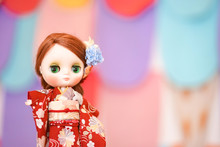 Cute Doll Wearing Kimono. An Adorable BJD Doll  In Red Japanese Kimono Traditional Dress. (BJD Is Ball-jointed Doll)