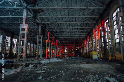 Printed kitchen splashbacks Old abandoned buildings Large industrial hall illuminated by red lights. Abandoned Voronezh excavator plant