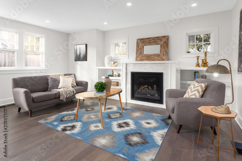 Obraz Beautiful living room interior with hardwood floors and fireplace in new luxury home - fototapety do salonu
