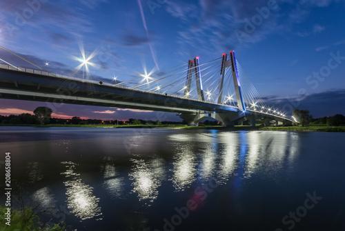 Fototapeta modern bridge over Vistula river, Krakow, Poland, illuminated in the night obraz