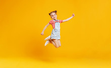 Funny Child Girl Jumping On Co...