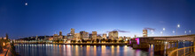 Waterfront Night City Skyline With Bridges