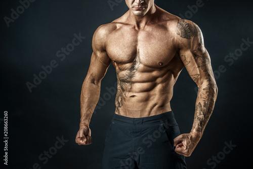Fotografie, Obraz  Unrecognizable Strong bodybuilder with six pack