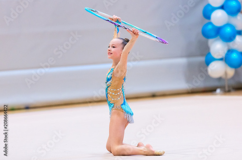 Tuinposter Gymnastiek Adorable girl competing in rhythmic gymnastics