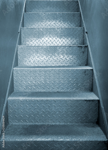 Grey Steel Industrial Staircase With Rough Patterned Grip Texture In