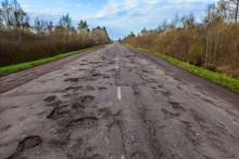 Dangerous Potholes In The Asphalt Rural Road. Road Damage