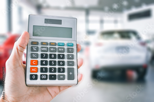 Man Holding Or Pressing Calculator For Business Finance On Car