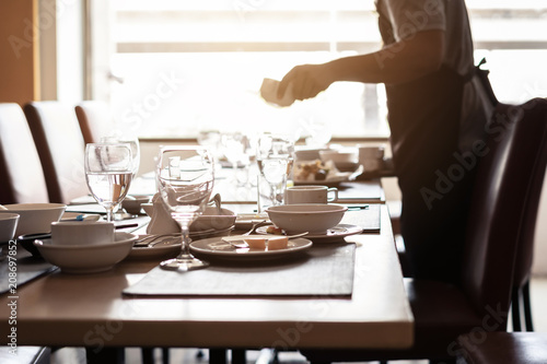 Empty dirty glasses and plates on dinning table in restaurant